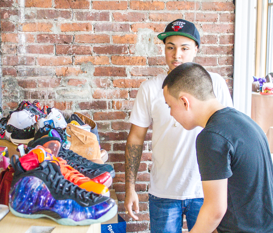 Sneaker aficionado looking at sneakers on display by a seller from Providence, RI.